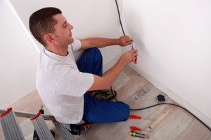 man installing electrical wiring